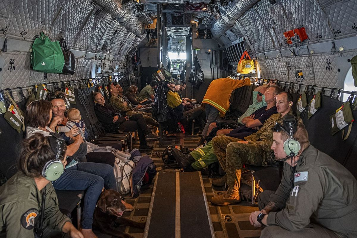 Evacuees and others aboard a Royal Australian Air Force flight from Mallacoota Airport in Mallacoota, Australia, Jan. 12, 2020. PHOTO: THE NEW YORK TIMES