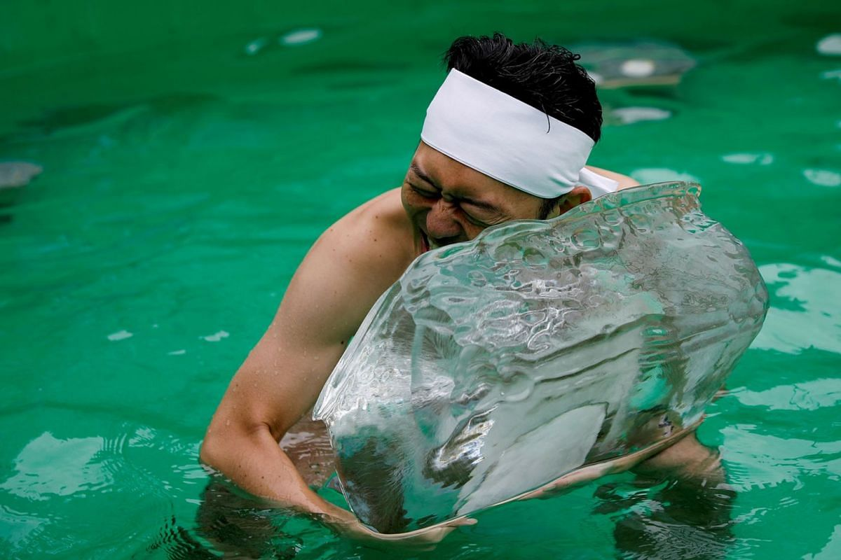 A man holds an ice brick after praying in ice-cold water in a ceremony to purify his soul and wish for good health in the new year at the Teppozu Inari shrine in Tokyo, Japan, January 12, 2020. PHOTO: REUTERS