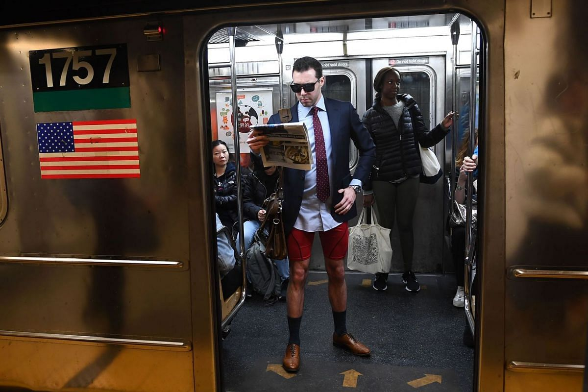 "Participants in the 19th Annual ""No Pants Subway Ride"" travel in the subway on January 12, 2020 in New York. PHOTO: AFP"