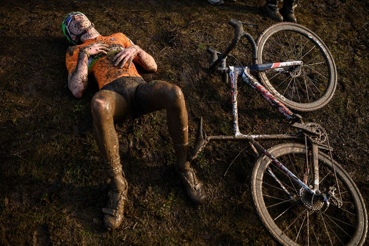 A rider recovers after competing in the Junior Men race of the British Cycling National Cyclo-Cross Championships at Shrewsbury Sports Village on January 12, 2020 in Shrewsbury, Central England. PHOTO: AFP