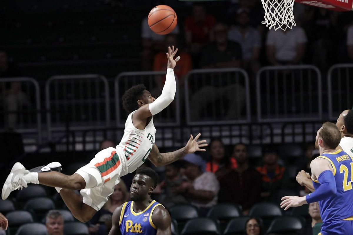 Miami guard Chris Lykes (0) shoots over Pittsburgh forward Eric Hamilton (0) during the first half of an NCAA college basketball game, Sunday, Jan. 12, 2020, in Coral Gables, Fla. PHOTO: AP