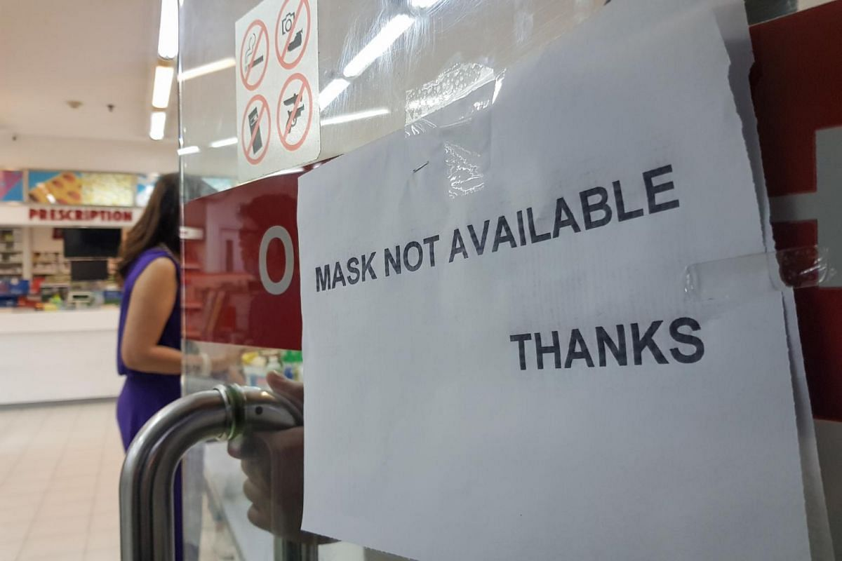 A drug store sign in Makati south of Manila, Philippines, indicates the unavailability of masks on Jan 12, 2020. Drifting ash from the volcano induced health officials to urge the public to use dust masks when going out.