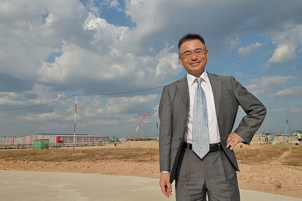 JAPAN Mr Yoshihisa Tonozuka, managing director of Toyota Myanmar, at the construction site for Toyota's new factory in Thilawa SEZ, arguably Myanmar's most developed industrial park. Above: The Myanmar subsidiary of Singapore-listed agribusiness gian