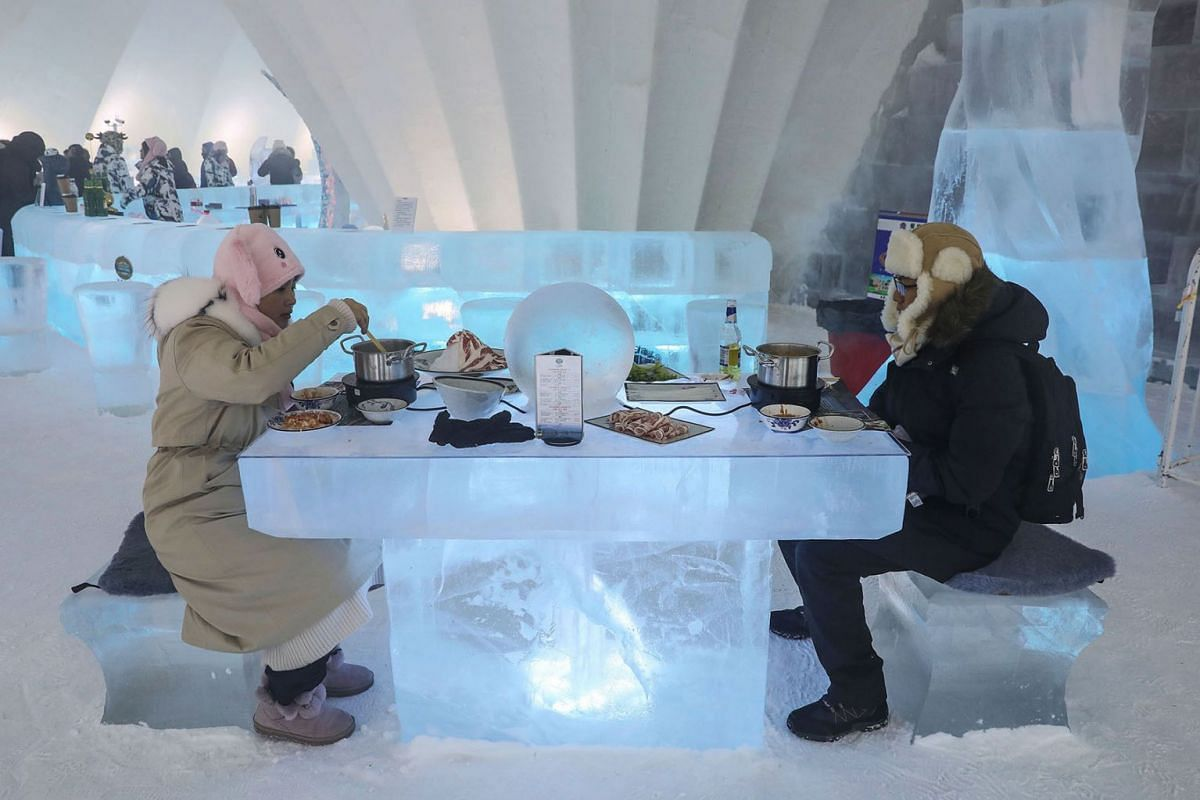 This photo taken on January 13, 2020 shows people enjoying hotpot on ice-carved desks and chairs inside an igloo in Harbin in China's northeastern Heilongjiang province, during the annual Harbin International Ice and Snow Festival. PHOTO: AFP
