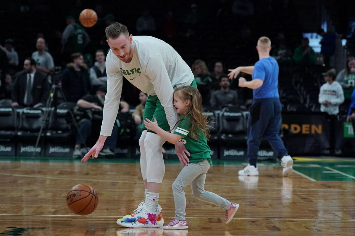 Boston Celtics forward Gordon Hayward (20) on the court with his daughter before the start of the game against the Detroit Pistons at TD Garden on Jan 15, 2020 in Boston, Massachusetts, USA;  PHOTO: USA TODAY SPORTS