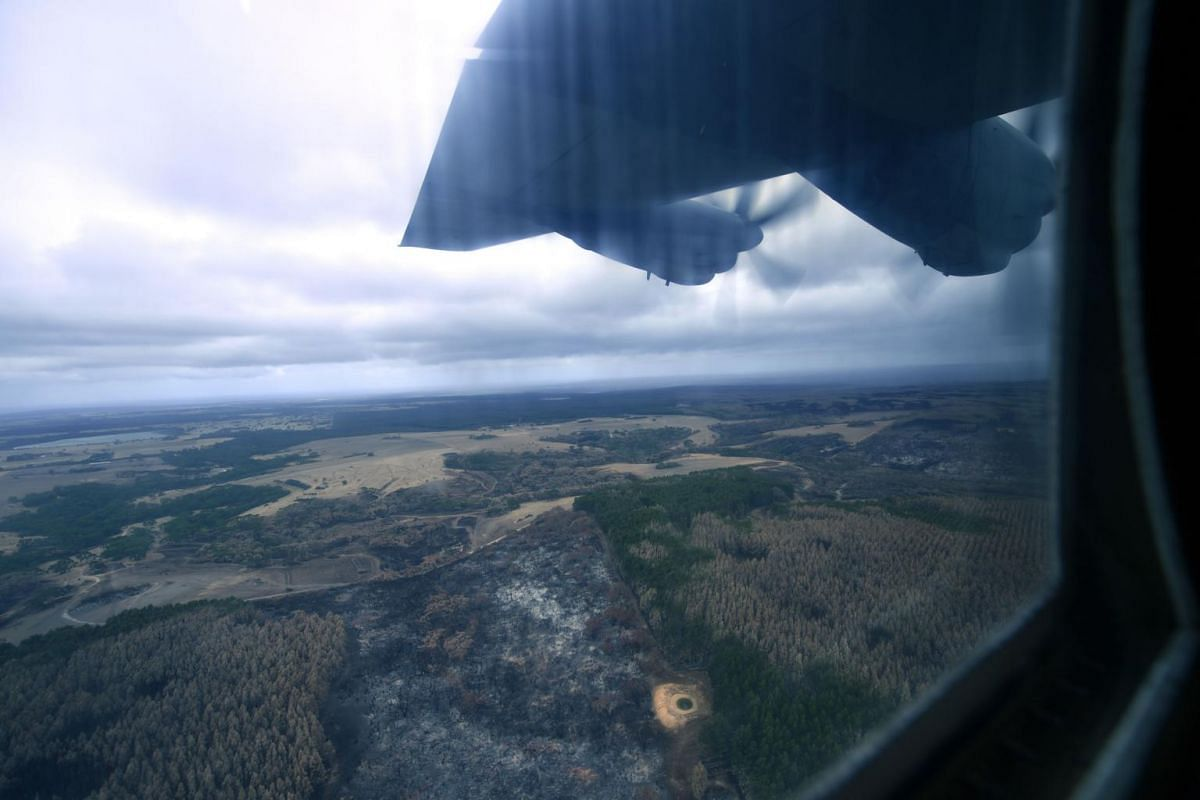 The burnt landscape of Kangaroo Island is seen from an Australian Defence Force C-130 Hercules aircraft, on Jan 16, 2020.