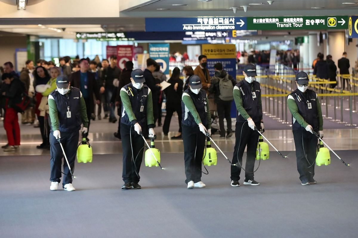 Quarantine workers spray disinfectant at Incheon International Airport, in Incheon, South Korea, 21 January 2020, to prevent the advance of a new strain of coronavirus now spreading in China and other parts of Asia. PHOTO: YONHAP VIA EPA-EFE
