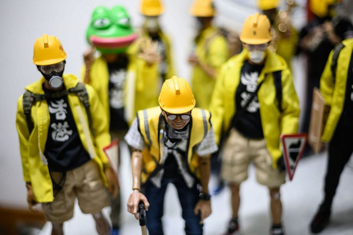 A photo issued on Jan 20, 2020, shows 1:6 scale action figures depicting characters involved in the Hong Kong protests, in Hong Kong, in a photo taken onJanuary 14, 2020 . Intricately detailed Hong Kong protester figurines have become the latest must