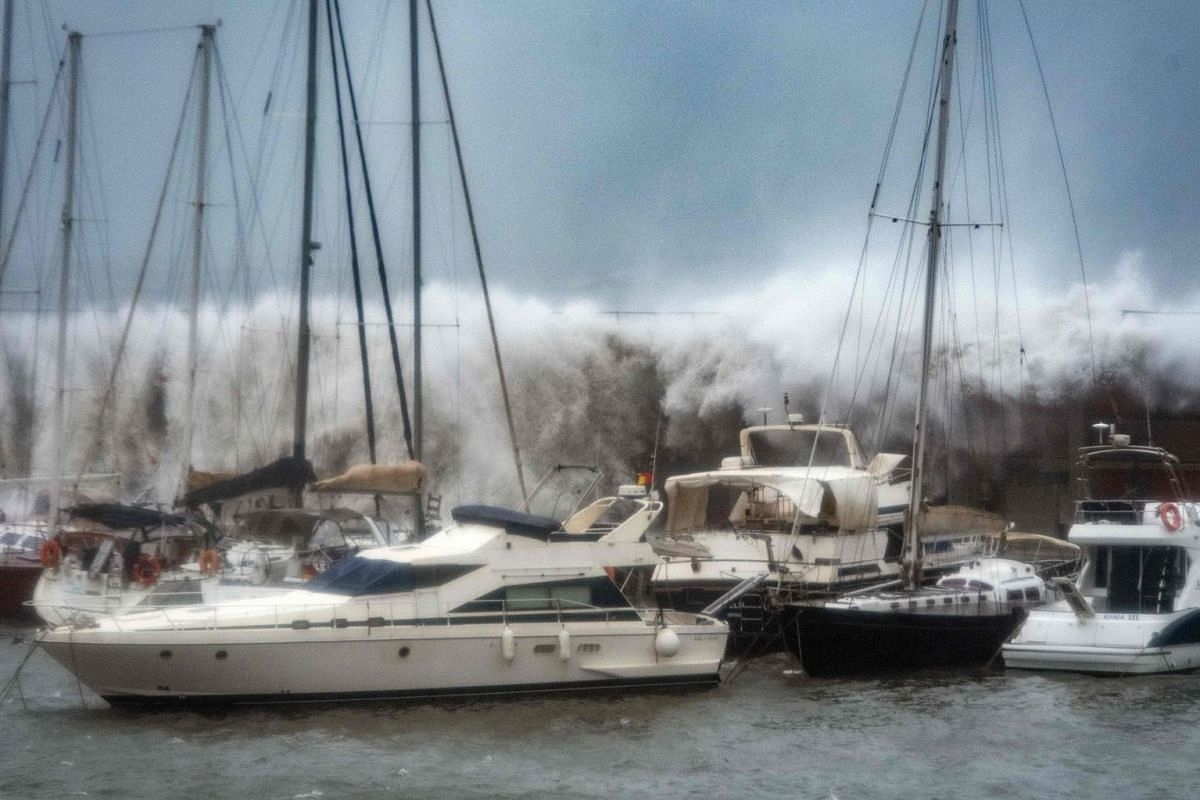 Big waves overpass a breakwater at the Port Olympic marina in Barcelona as storm Gloria batters Spanish eastern coast on January 21, 2020. PHOTO: AFP