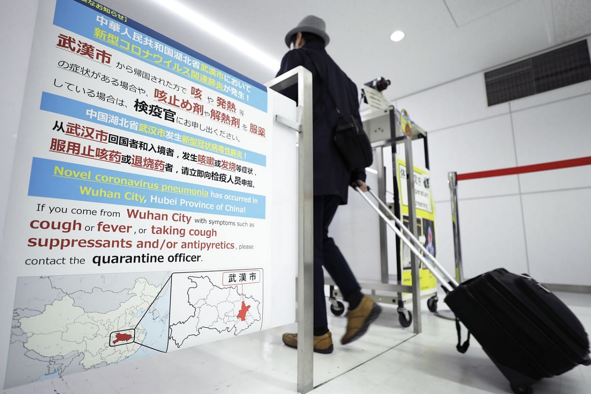 A notice offering guidance to travellers from Wuhan is displayed at a quarantine station at Narita Airport in Narita, Chiba Prefecture, Japan, on Jan 22, 2020.