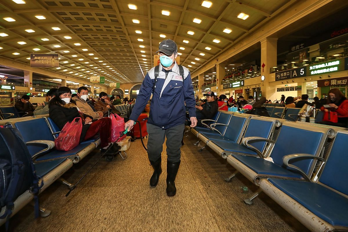 A staff member disinfects at the Hankou Railway Station in Wuhan, in China's central Hubei province, early on Jan 22, 2020.