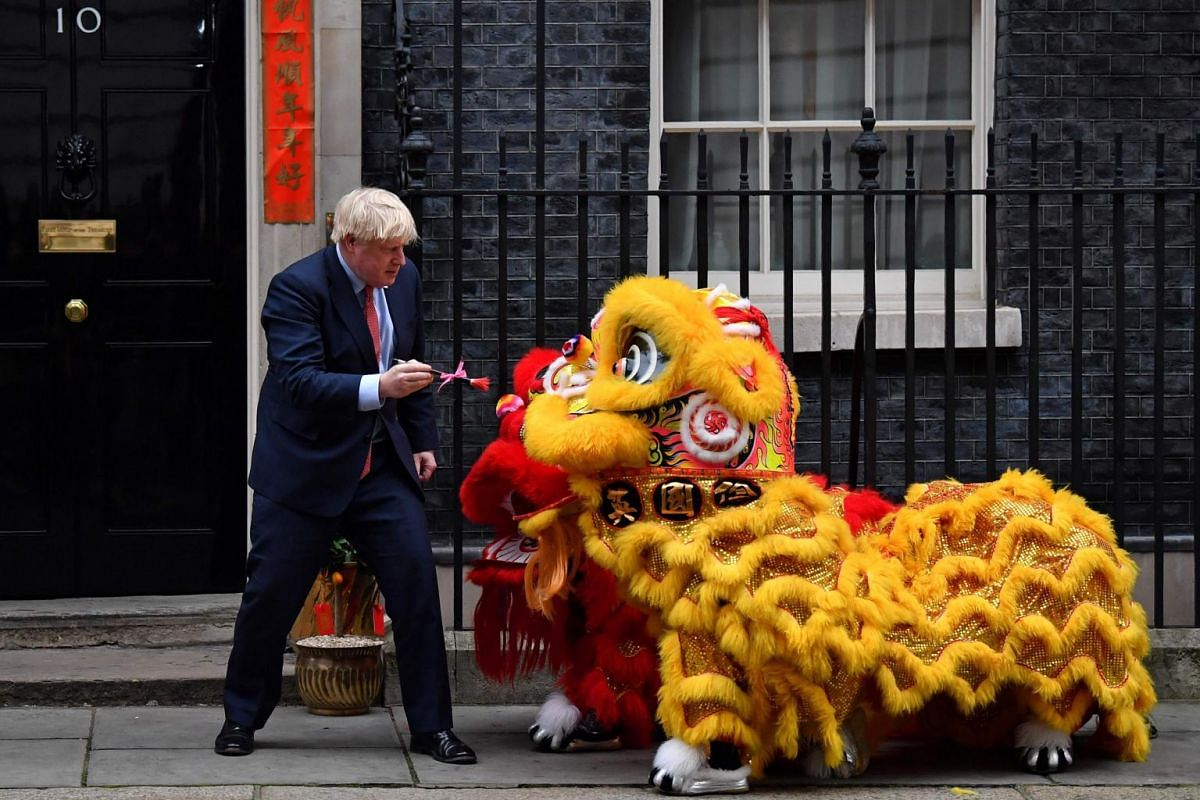 Britain's Prime Minister Boris Johnson preparing to paint the eyes on Chinese Lions, as he hosts a Chinese New Year reception at 10 Downing Street in central London, on Jan 24, 2020.
