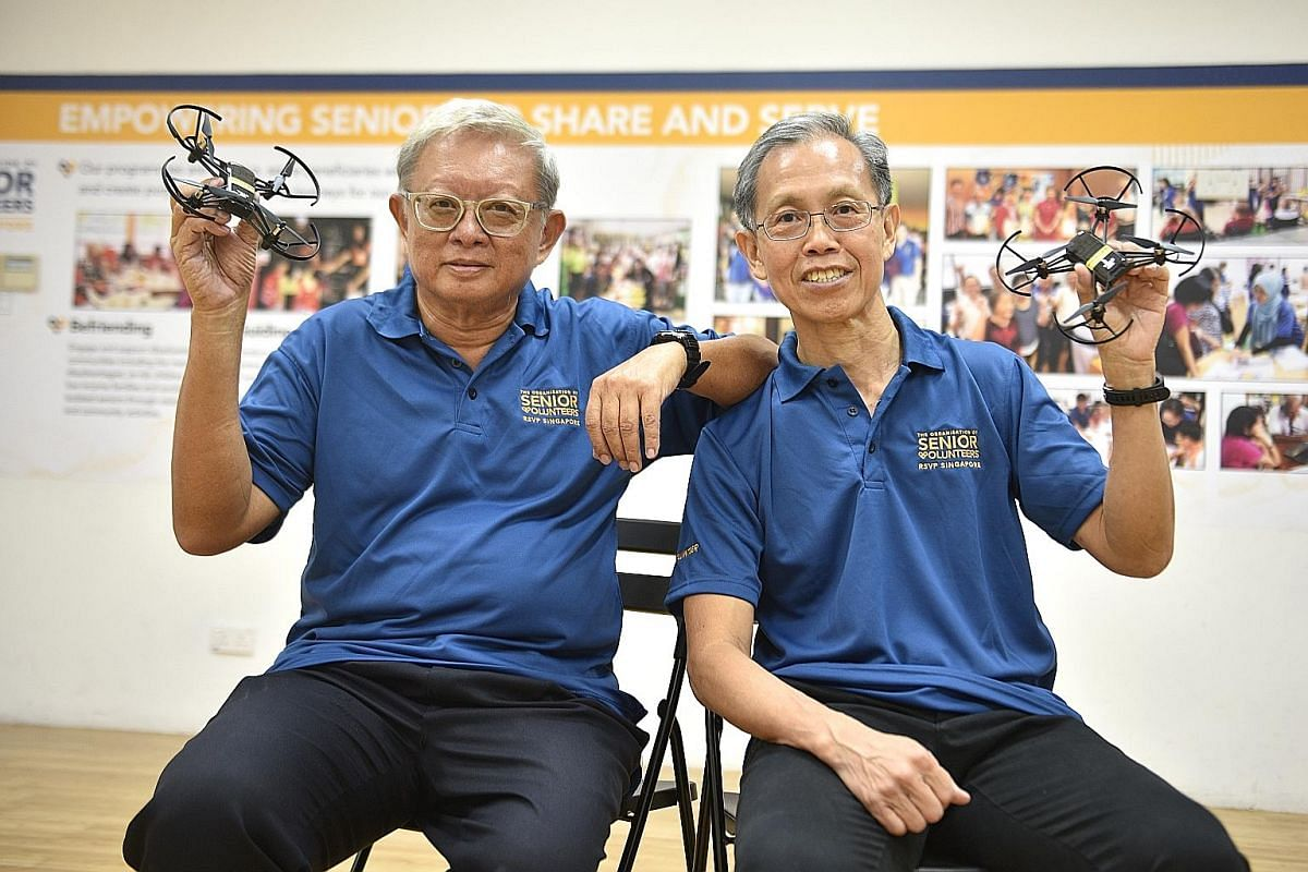 Seen here with their drones, Mr Ong Han Min (left) and Mr Han Cheng Kwang's interest grew from a coding course they took.