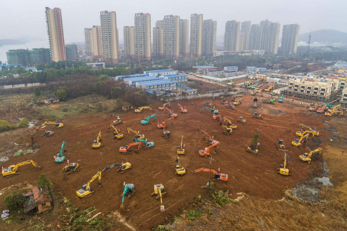 Excavators clearing the land at the construction site of the new hospital in Wuhan on Jan 24, 2020.