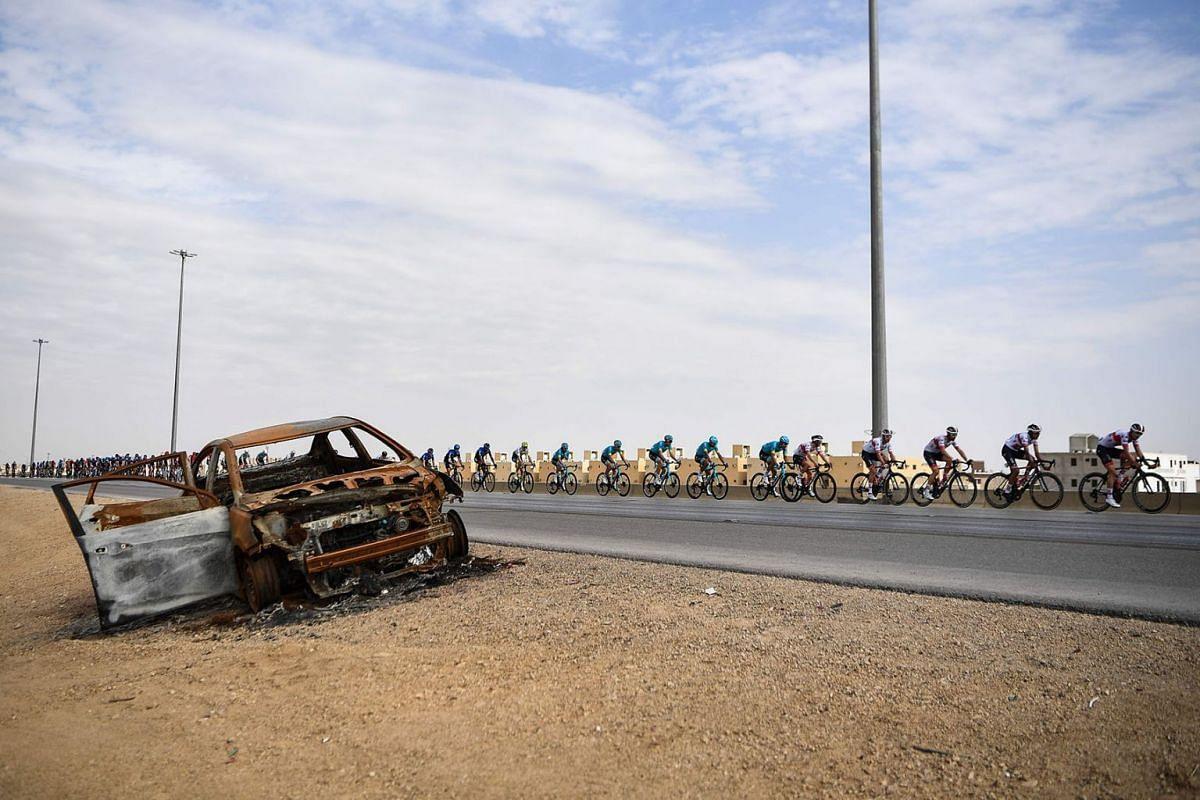 The pack rides during the third stage of the Saudi Tour, from King Saud University to Al-Bujairi near Riyadh, Saudi Arabia, on Feb 6, 2020.