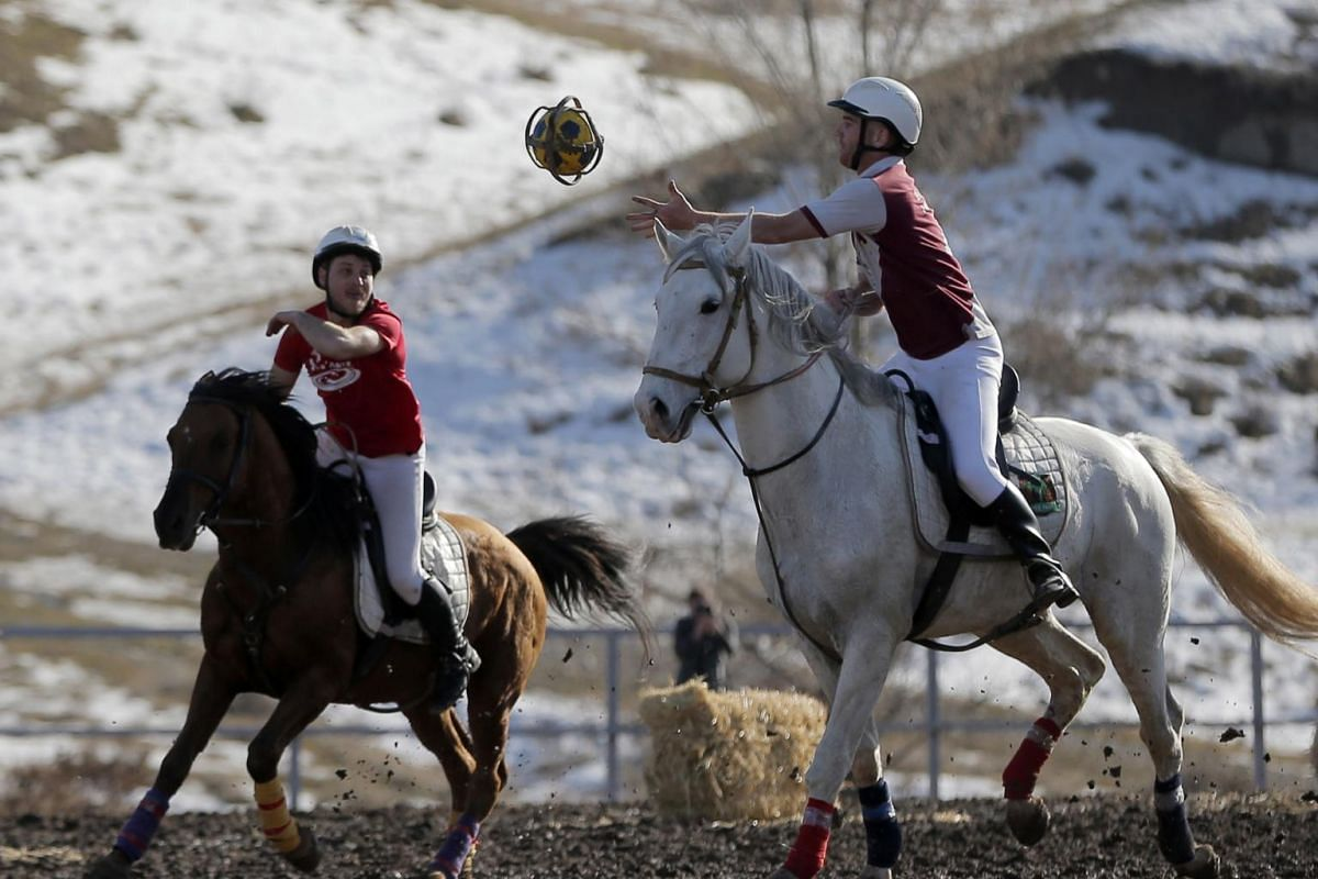 Horseball players from France and Canada play at the Hyde Park equestrian centre in the village of Kok-Dzhar near Bishkek, Kyrgyzstan, on Feb 9, 2020.