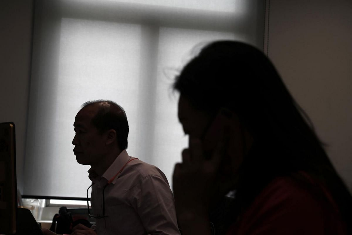 A silhouette of Mr Jeremy Chan (left) seen at work, a caregiver who in turn through the process of caregiving developed a mental health condition.