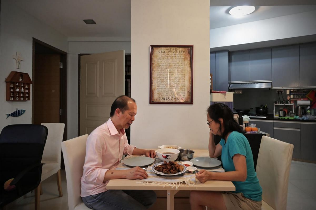 Mr Jeremy Chan (left) and Madam Janet Lee say grace before their dinner at home on Feb 7, 2020.