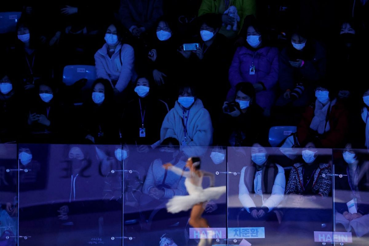 Spectators wearing masks at the ISU Four Continents Figure Skating Championships in Seoul on Feb 9, 2020.