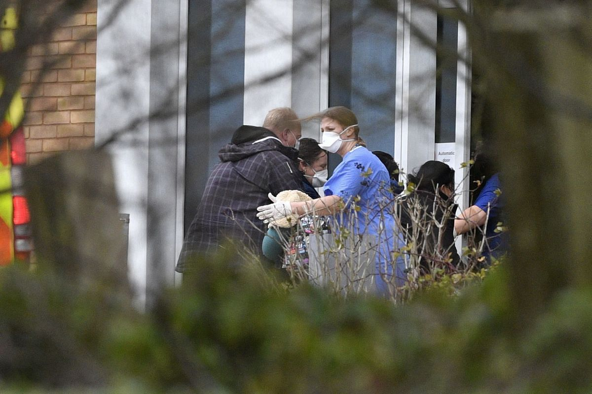 British nationals evacuated from the coronavirus-hit Chinese city of Wuhan arriving at Kents Hill Park, a hotel and conference centre in Milton Keynes, Britain, on Feb 9, 2020.