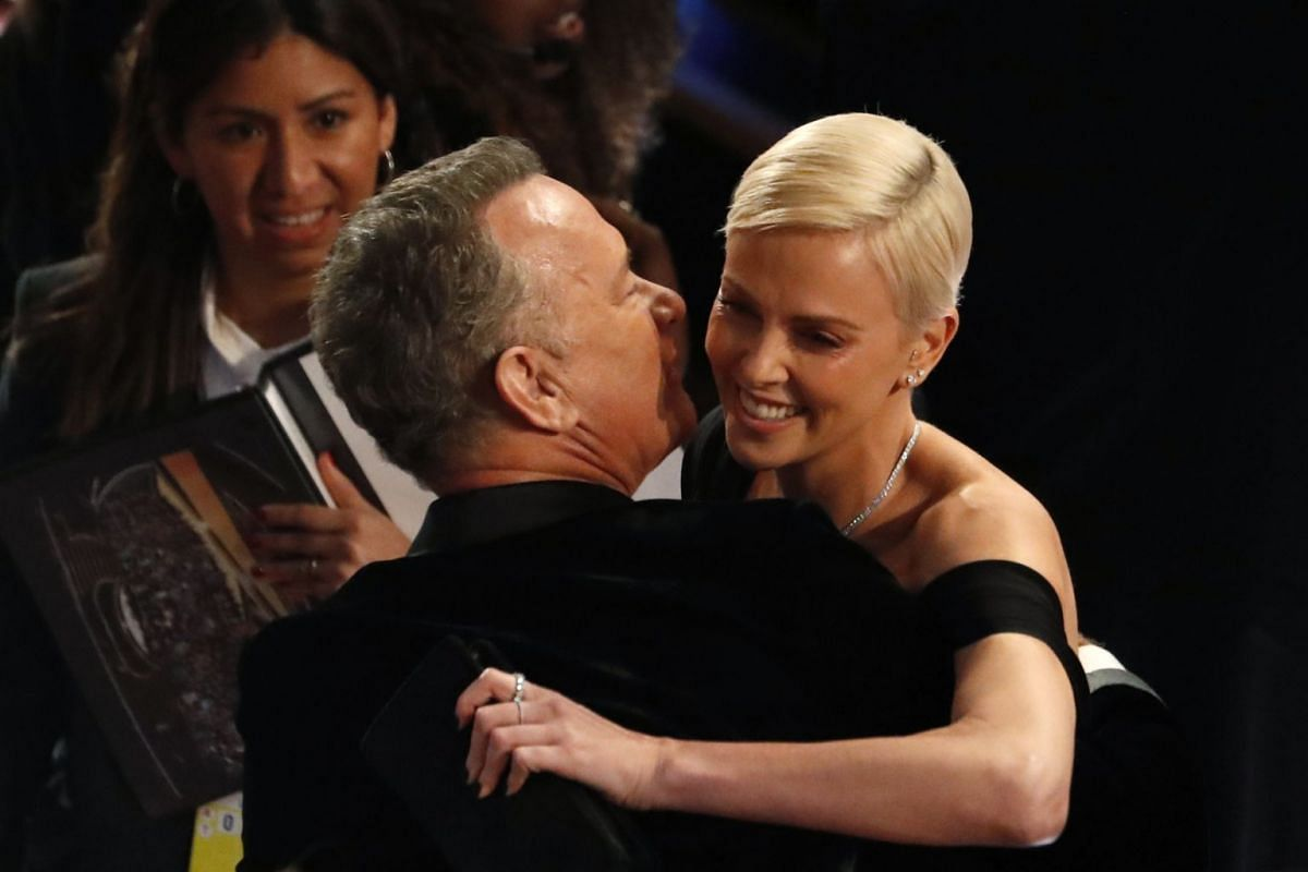 Charlize Theron with Tom Hanks at the 92nd Academy Awards on Feb 9, 2020.