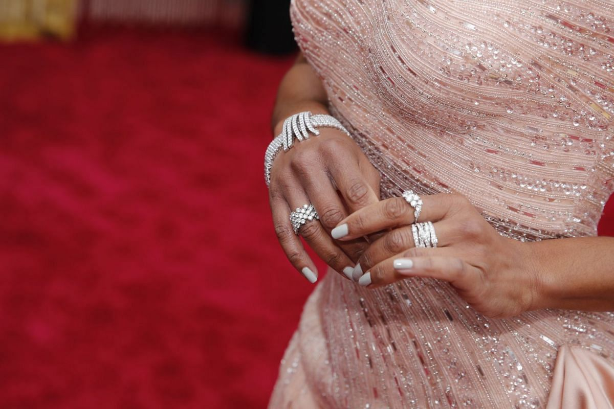 A closer view of American actress Regina King's jewellery as she poses on the red carpet at the 92nd Academy Awards in Hollywood on Feb 9, 2020.