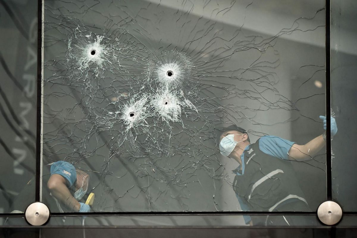 Forensics police inspect bullet holes inside the Terminal 21 shopping mall on February 10, 2020, where a mass shooting took place, in the Thai northeastern city of Nakhon Ratchasima, on February 9, 2020. PHOTO: AFP