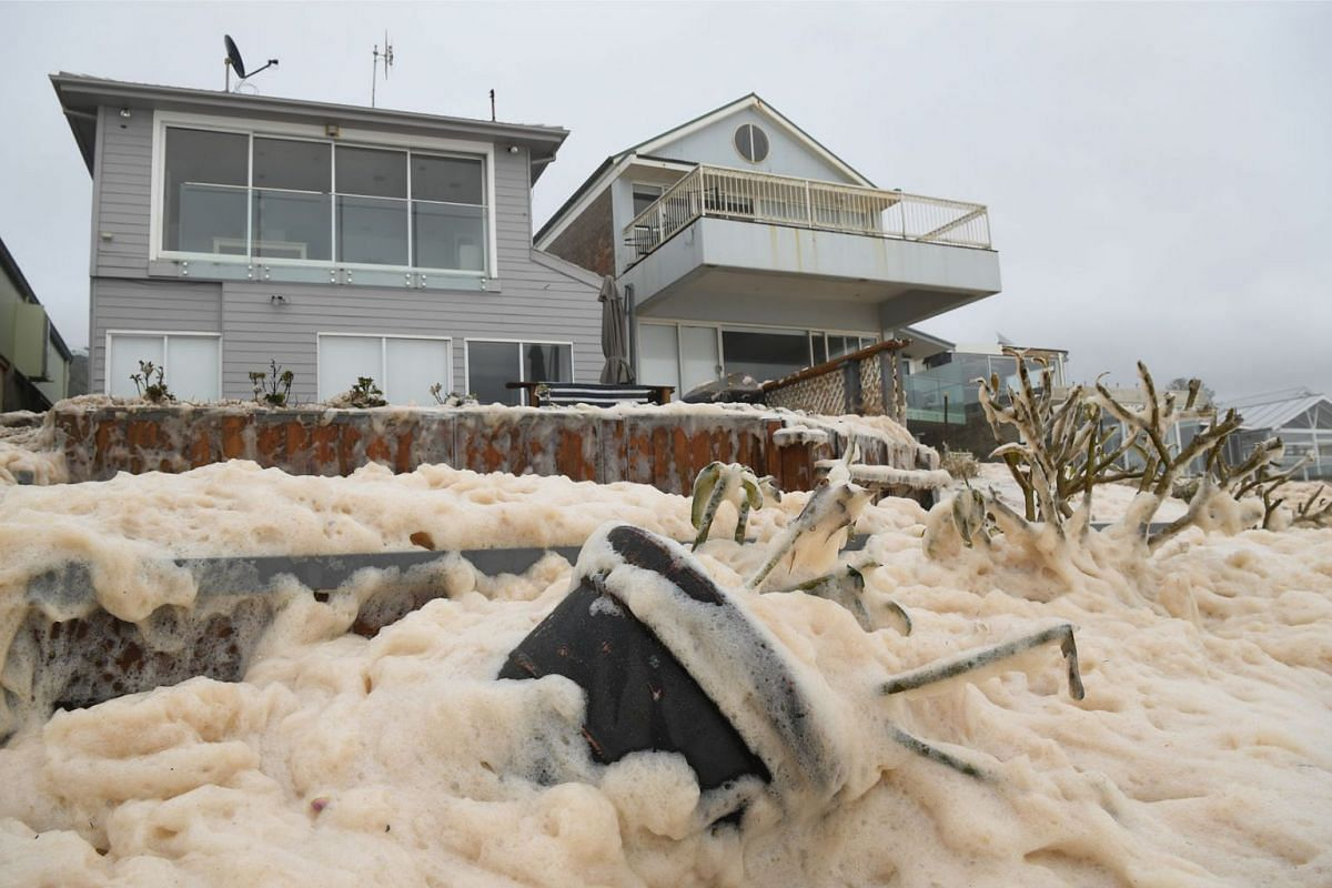 Sea foam brought by waves after heavy rain and storms at Collaroy in Sydney, Australia, February 10, 2020. PHOTO: EPA-EFE