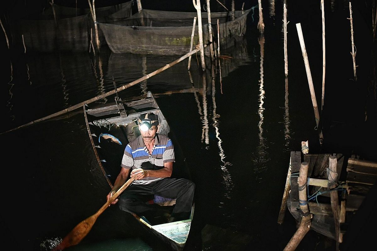Right: A location believed to be an illegal mining pit in Samarinda, the provincial capital of East Kalimantan. Left: Fish breeder Marsulap returning from his fish farm in a mine lake that is now a source of income for his family. Far left: Miner Sug