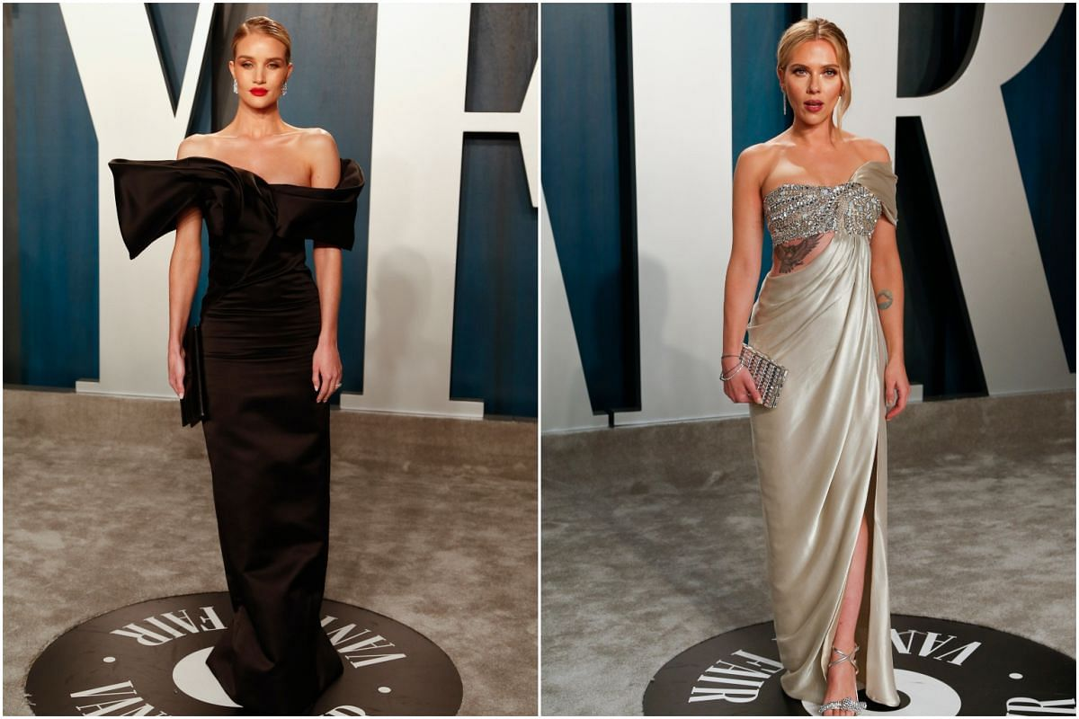 Model Rosie Huntington-Whiteley and actress Scarlett Johansson at the Vanity Fair Oscar party held after the 92nd Academy Awards.