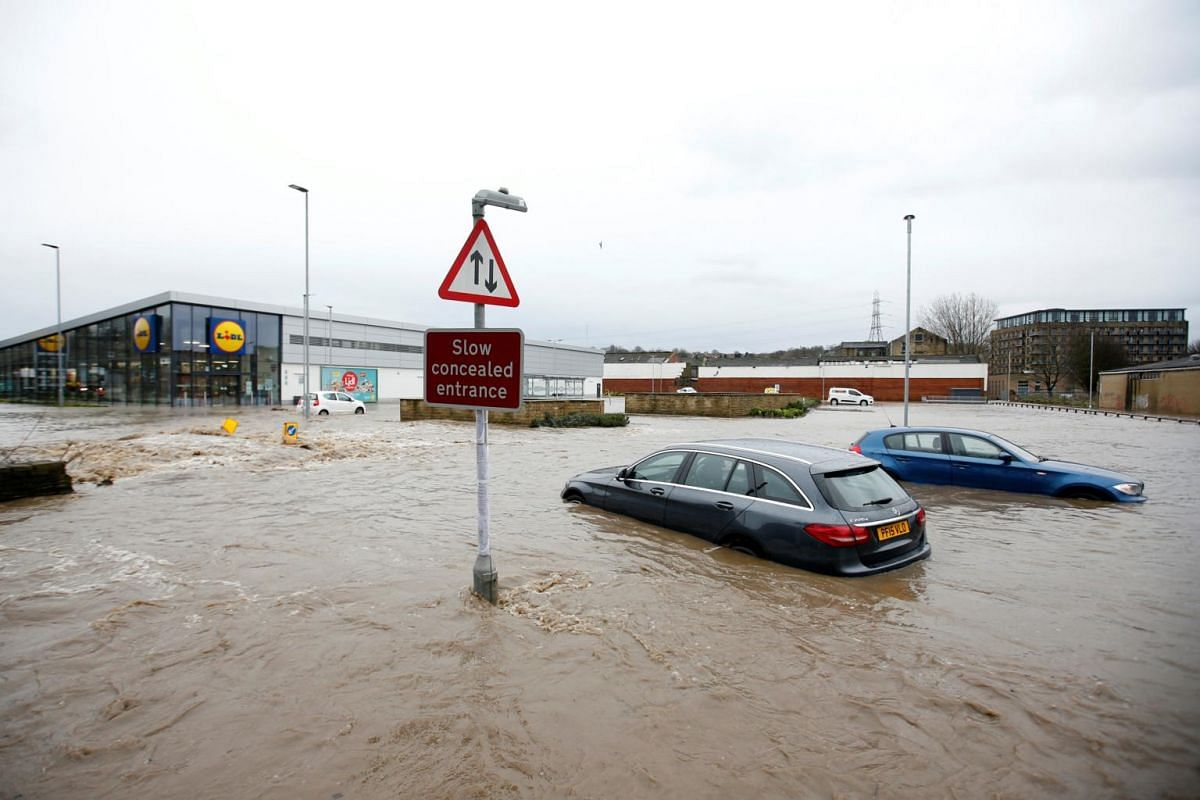 Abandoned cars sit in floodwater in Brighouse, Britain, on Feb 9, 2020.