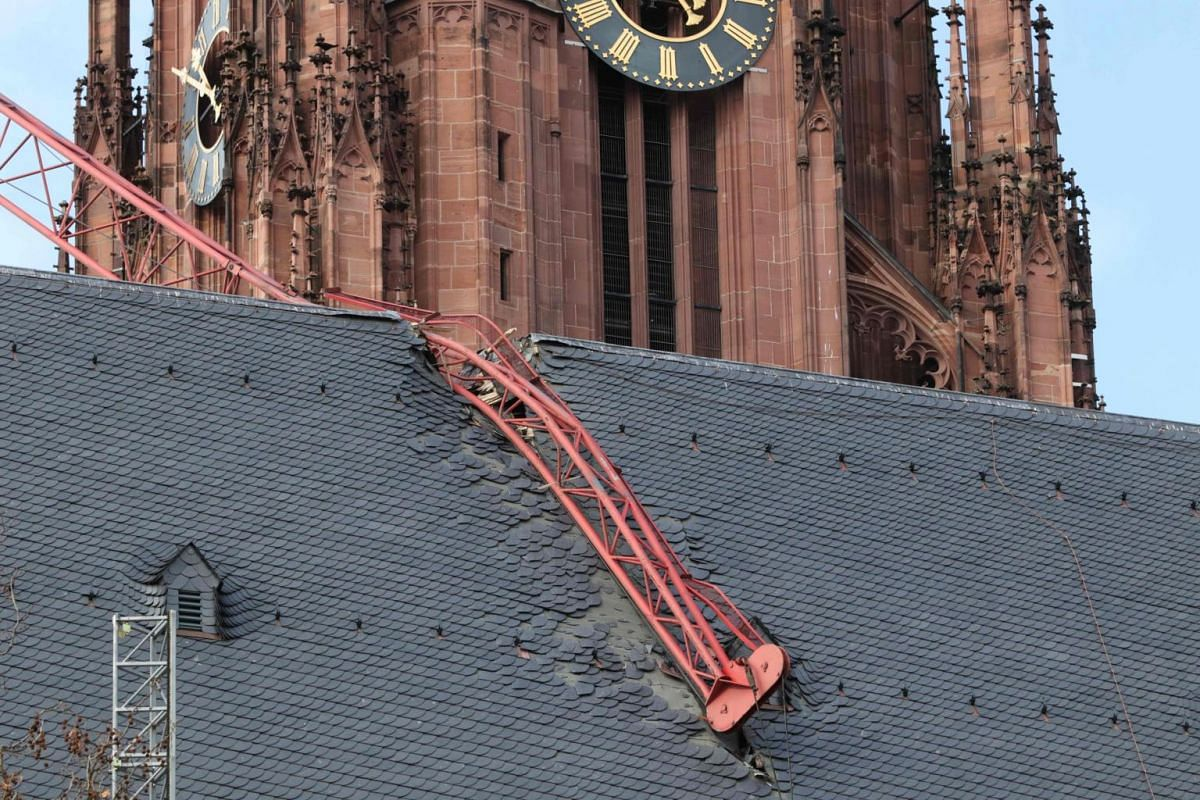 A cathedral is damaged by a construction crane which collapsed during the passage of Storm Ciara in Frankfurt am Main, Germany, on Feb 10, 2020.