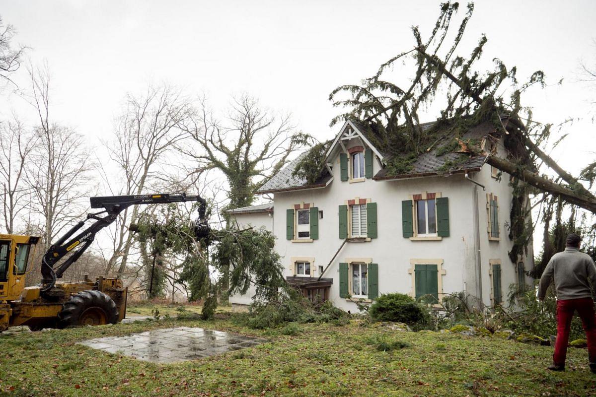 A view of a house damaged by fallen trees in Montmollin, Switzerland, on Feb 10, 2020.