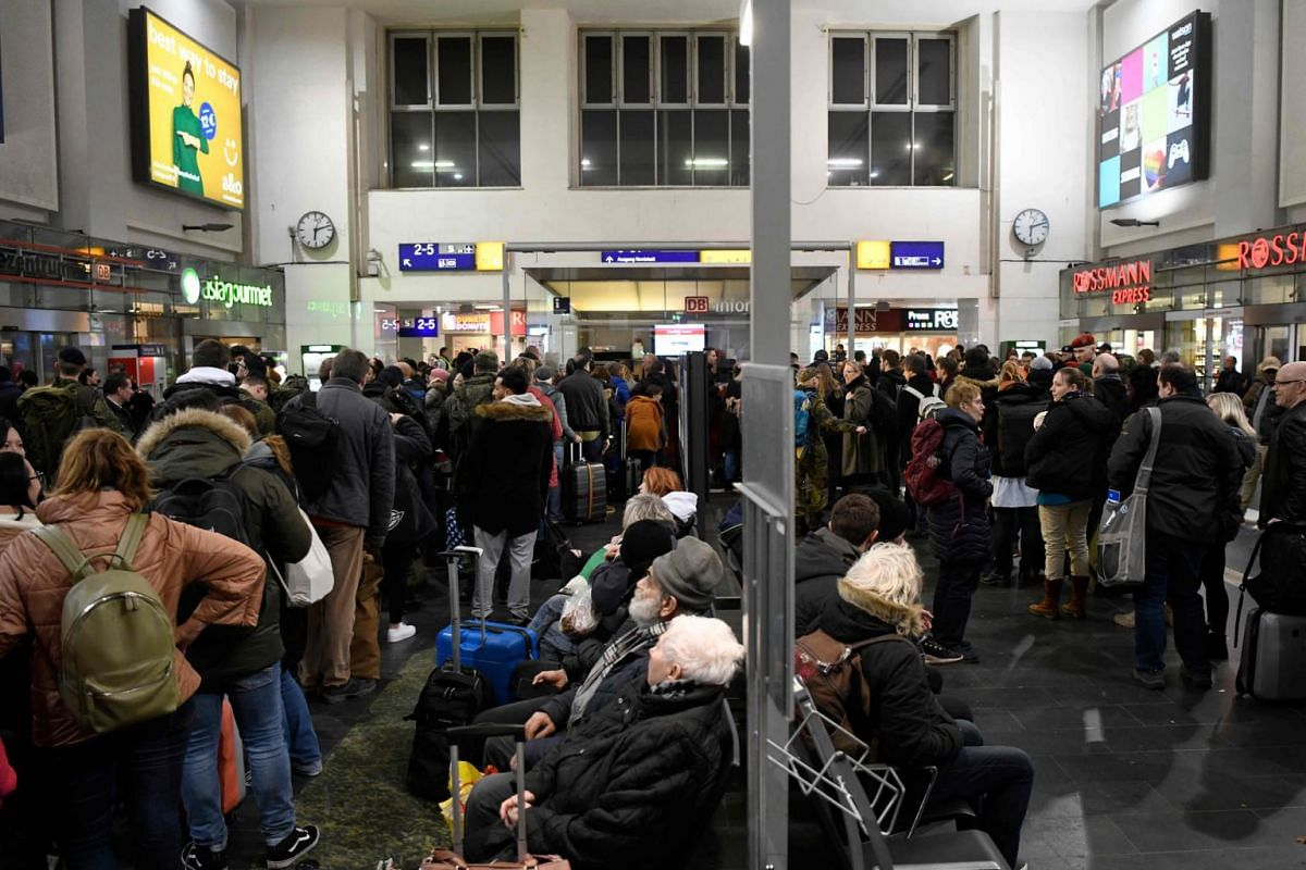 Passengers wait at the main railway station in Dortmund, Germany, on Feb 9, 2020.