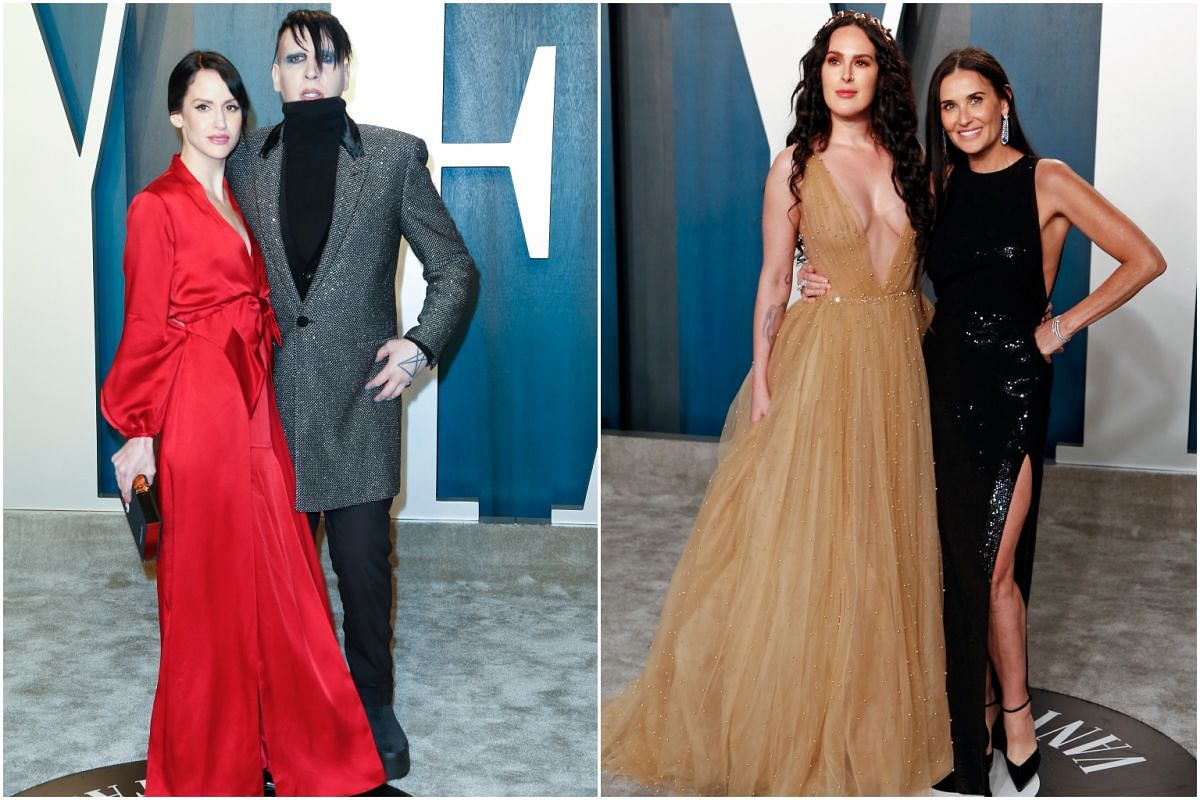 Singer Marilyn Manson with Lindsay Usich (left), and Rumer Willis with Demi Moore (right).