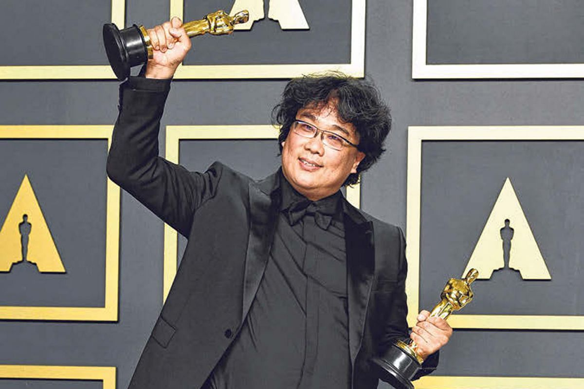 Director Bong Joon-ho with his Academy Awards for his film, Parasite, in Hollywood.