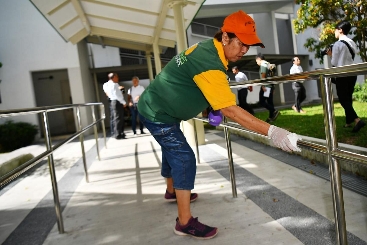 A cleaner cleaning the railings of a barrier-free ramp in Tampines, Singapore, on Feb 5, 2020.