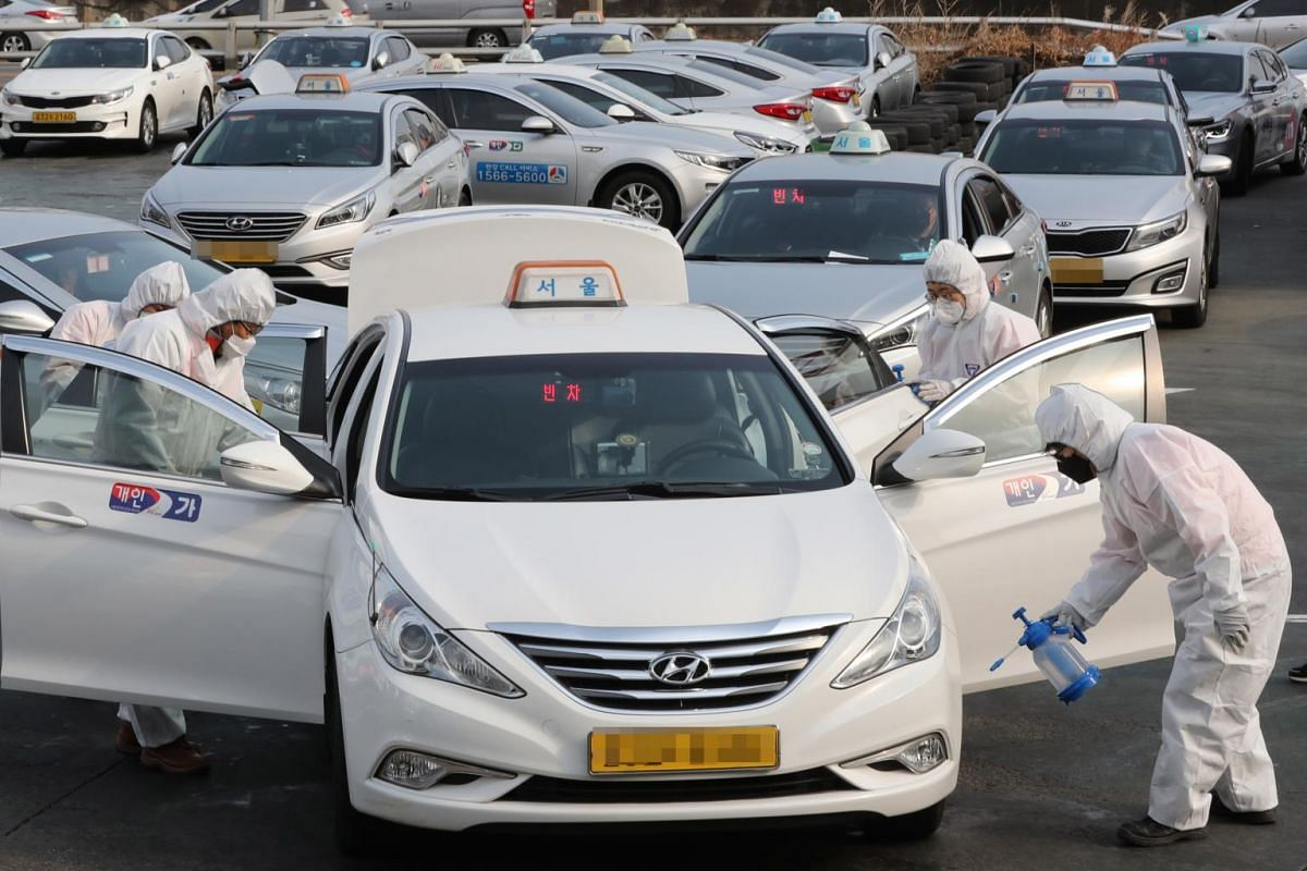 Quarantine officials disinfecting taxis at a liquid petroleum gas station in Seoul on Feb 4, 2020.