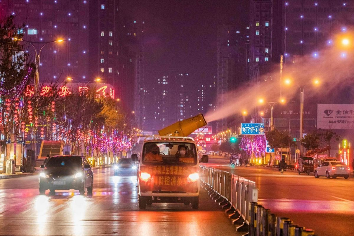 A sanitation vehicle disinfecting the street in Tengzhou in China's eastern Shandong province on Feb 11, 2020.