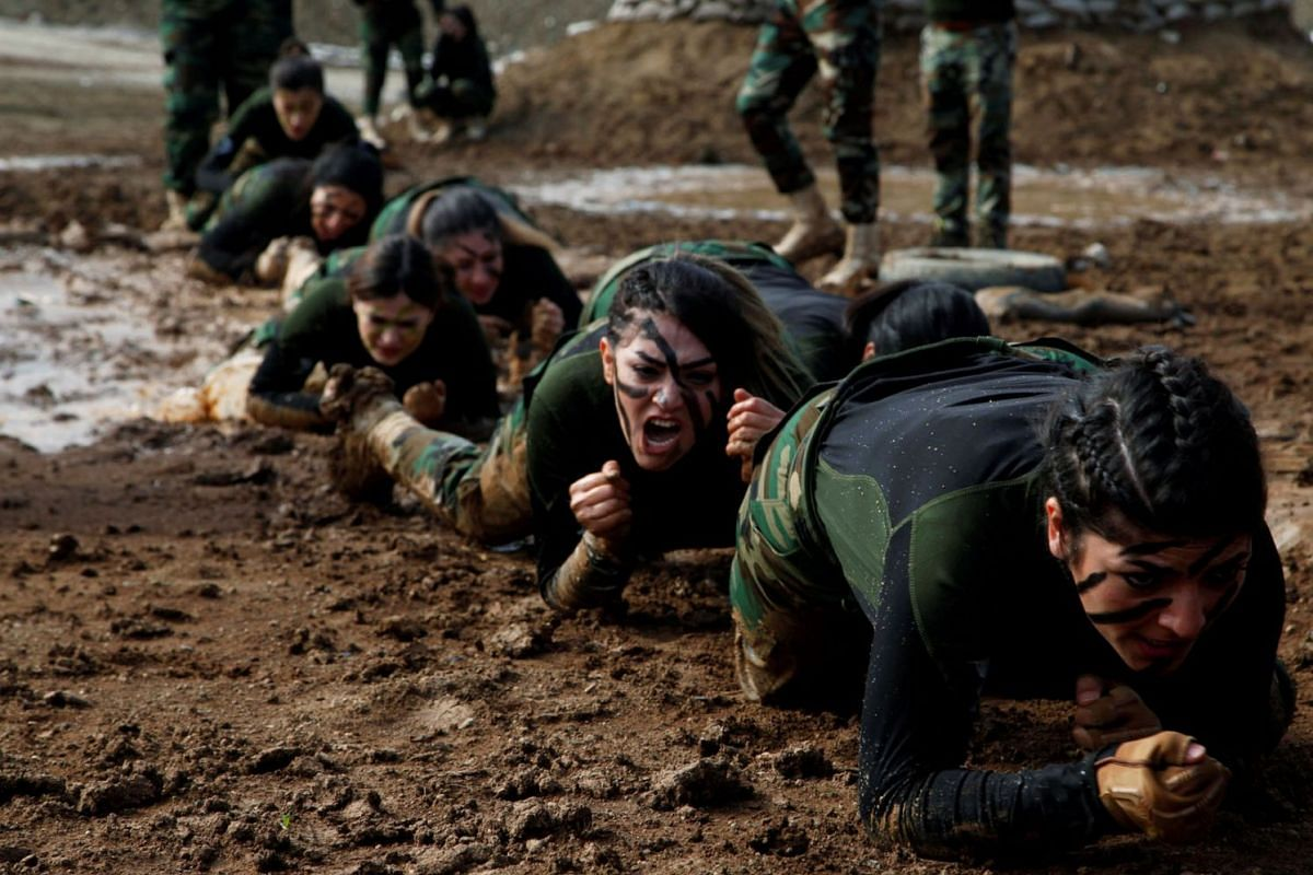 Members of Kurdish Peshmerga Special Forces demonstrate their skills during their graduation ceremony at a military camp in Soran district, in Erbil province, Iraq February 12, 2020. PHOTO: REUTERS