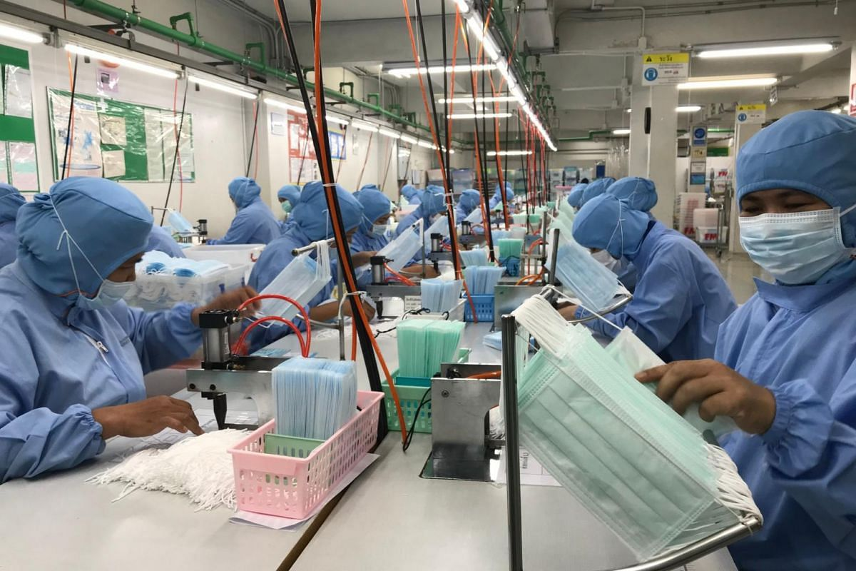 Workers produce masks at the Thai Hospital Product Company Ltd factory in Bangkok on Jan 30, 2020.