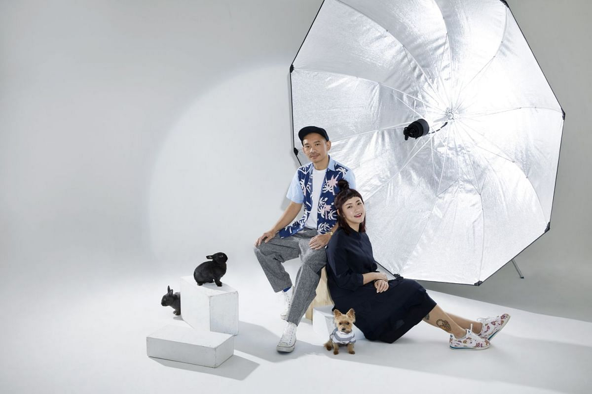 Producer Jasmine Tham and photographer Alvin Tang with their pets at their Ubi studio.