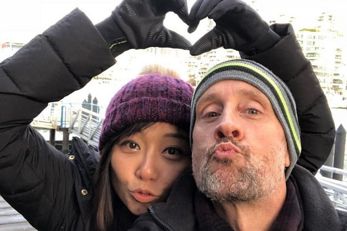 Ms Diana Ong with her partner Rand Rogers during a holiday in Vancouver. They draw clear lines between work and home life and travel for leisure at least once a year.