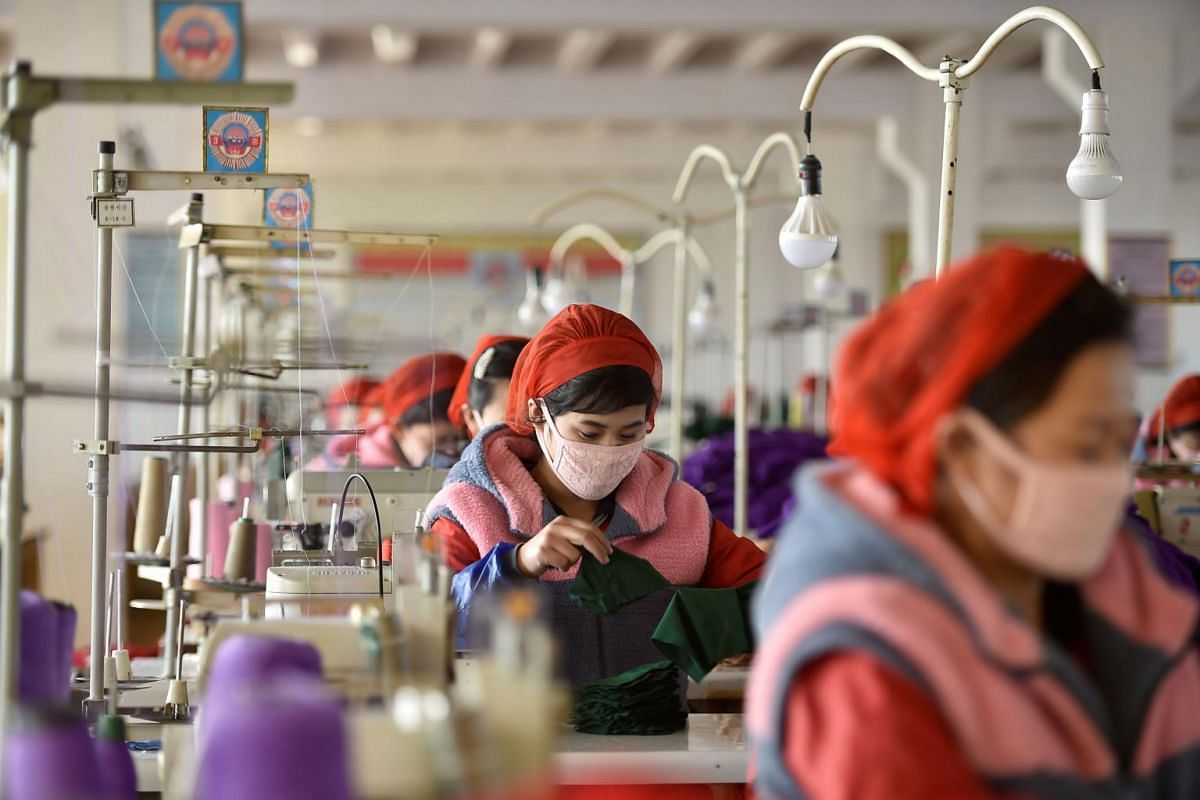 Workers producing masks at Songyo Knitwear Factory in Pyongyang on Feb 6, 2020.