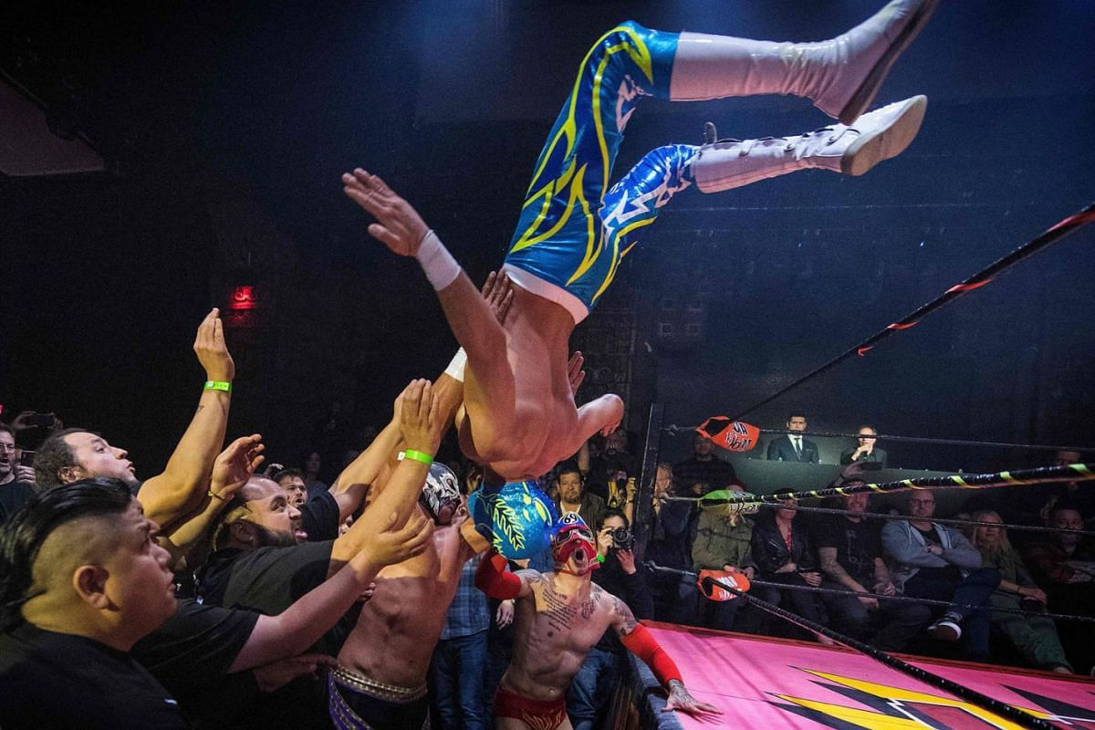 Nacho Libre wrestlers perform during the Lucha Vavoom 'Valentines Day' show at the Mayan Theatre, California, on February 12, 2020. PHOTO:  AFP