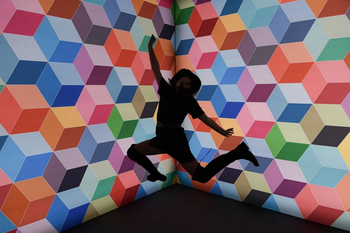 A woman poses for a picture during the pre-opening party at The WOW! Gallery Berlin, an interactive pop-up selfie museum in Berlin, Germany, February 13, 2020. PHOTO: REUTERS