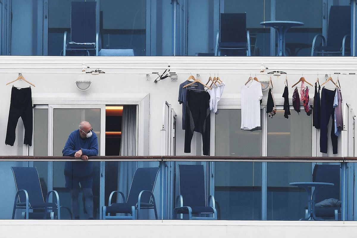 A passenger on a balcony of the Diamond Princess cruise ship on Feb 14, 2020.  The cruise ship off Yokohama has become the single largest cluster of coronavirus cases outside China.
