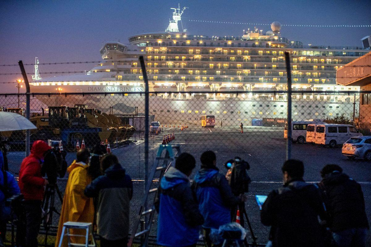 A bus approaching the Diamond Princess at Daikoku Pier Cruise Terminal in Yokohama on Feb 16, 2020.