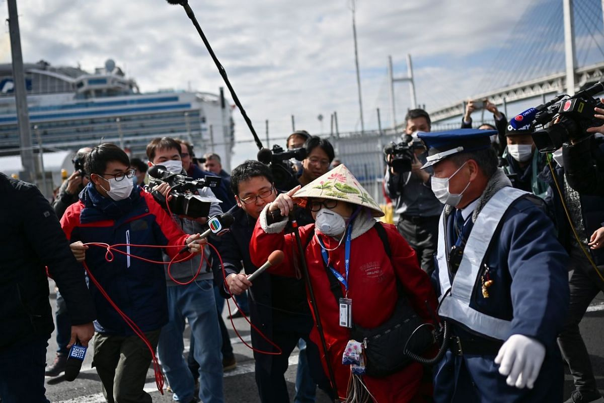 <p>A passenger (centre) disembarking the Diamond Princess cruise ship in Yokohama on Feb 19, 202. They are allowed to leave if they have tested negative for the virus after a 14-day quarantine.