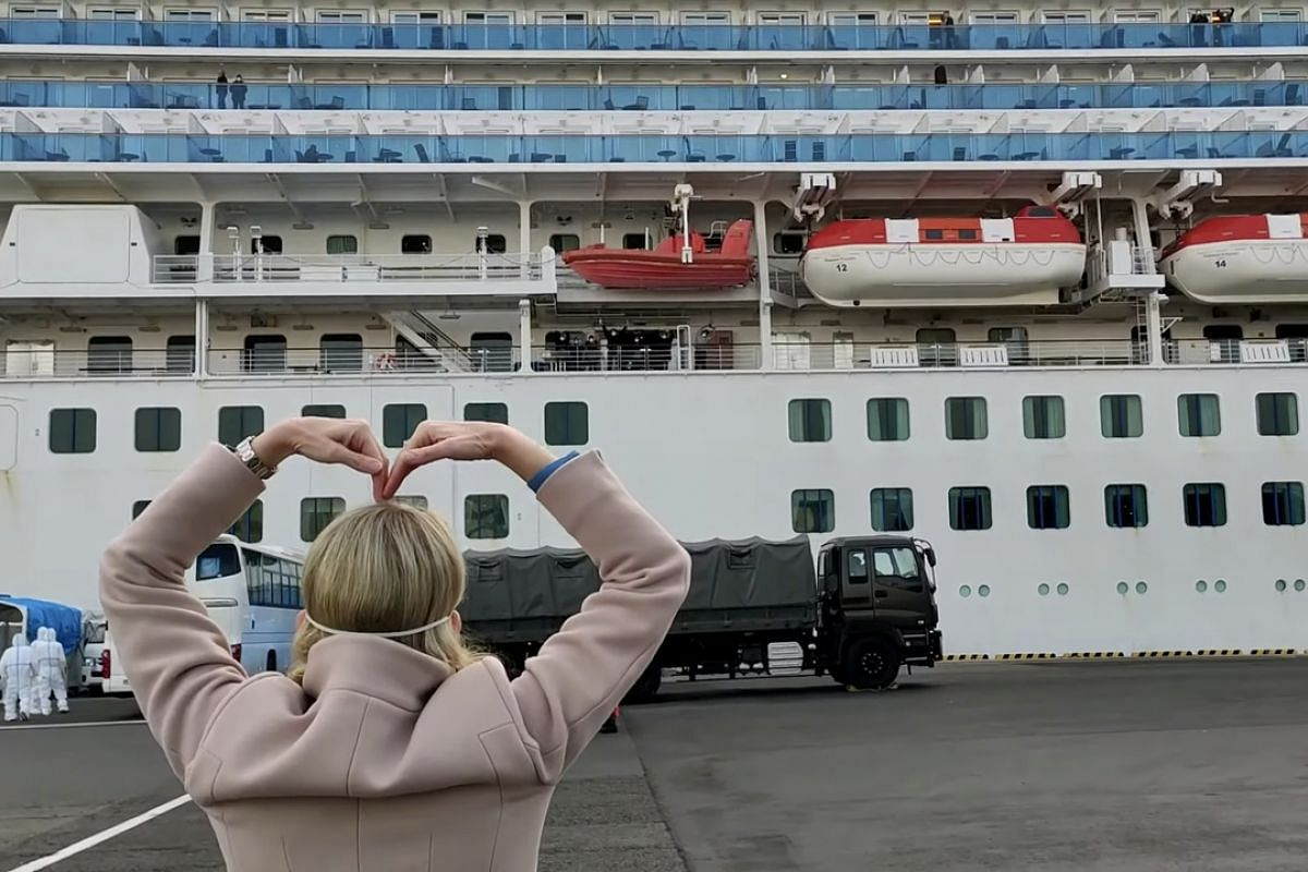 Princess Cruises president Jan Swartz is seen gesturing at the Diamond Princess on Feb 20, 2020, as passengers disembark  in this screengrab obtained from social media video.